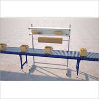 Box Handling Conveyor With Work Table