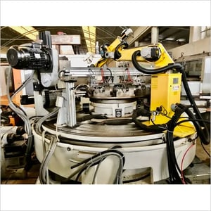 TRANSFER machine with ROTARY INDEXING TABLE by FIBROTAKT  equipped with ROBOT arm - ATOM 10.  COMPLETE OF ALL 8 STATIONS/HEAD.