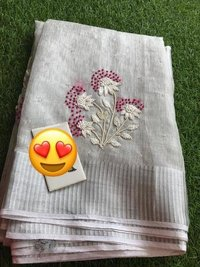 PURE TISSUE BY LINEN MACHINE CUT WORK EMBROIDERY SAREE .