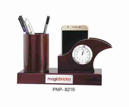 Clock With Pen And Mobile Holder