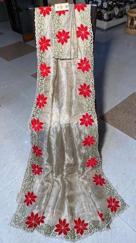 PURE TISSUE TUSSAR SILK CUT WORK SAREE .