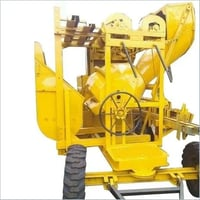 Concrete mixer with hopper and lift