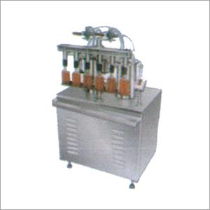 Semi Automatic Linear Vaccum Filler Machine