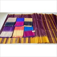 PURE TUSSAR SILK HANDCRAFTED TEMPLE BORDER WITH BOOTI WOVEN SAREES .