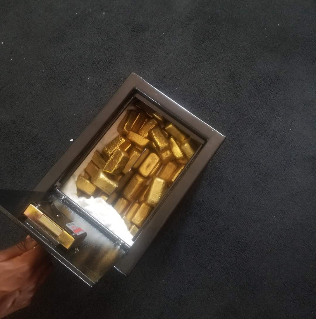Gold Bars And Gold Dusts