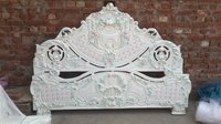 wooden carved bed in white deco