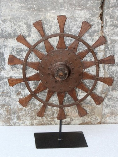 Wooden wheel on iron stand
