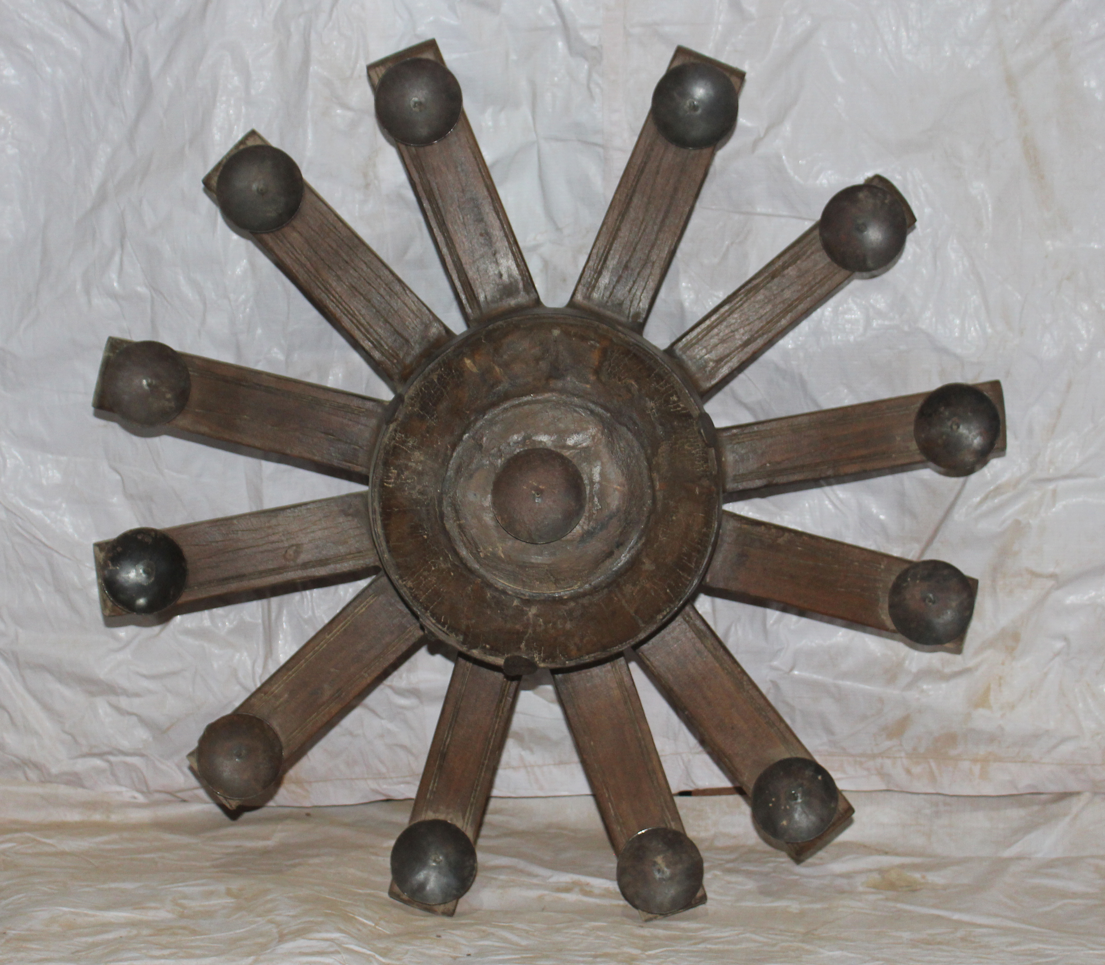 Wooden wheel candle stand