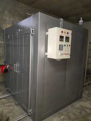 Oven to dry coatings on articles