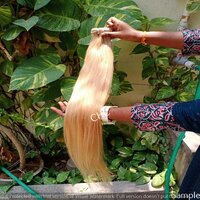 Blonde Human Hair Extensions With Wavy Hair