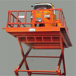 Track Hoist Hydraulic Power Scissor Lift Being Used For Three wheeler Lifting To First Floor