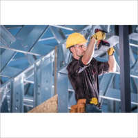 Worker On The Building Frame