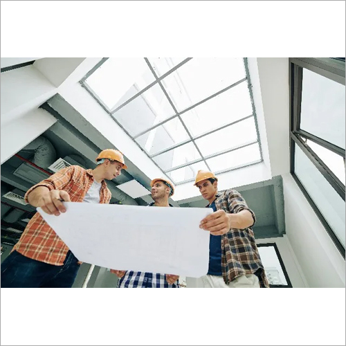 Manual Workers With Building Plan
