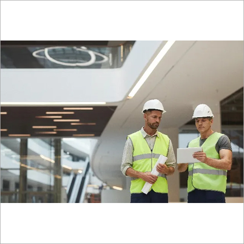 Construction Workers In Office Building