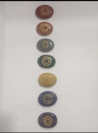chakra oval stone with engraving