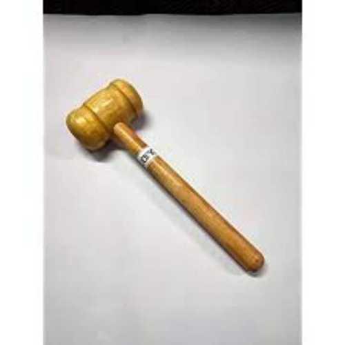 Cricket bat knocking wooden hammer