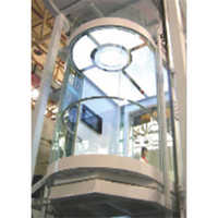 Round Glass Cabin with Stainless Steel Hair Line Finish Car